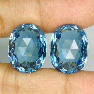 36.2ct oval blue topaz pair